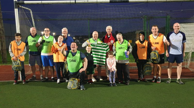 Members of Naomh Mearnog Special Needs GAC pose with their new Celtic kit bought with Trust-donated £50 vouchers.